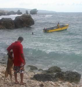 Man and dog at Martin's Bay, Barbados