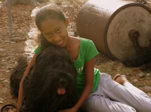 Rita, a Bouvier Des Flandres dog with a child